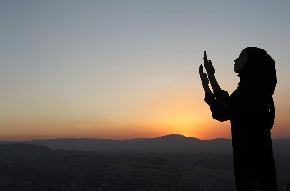 Girl praying at sundown