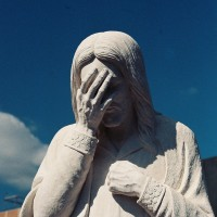 Jesus covering face