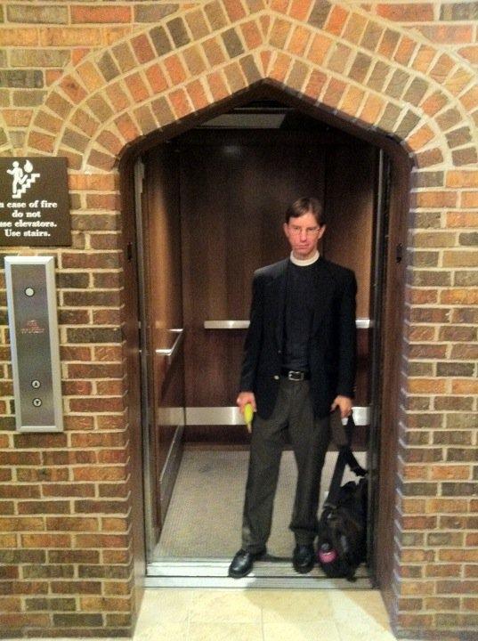Tim Schenck rides an old elevator down