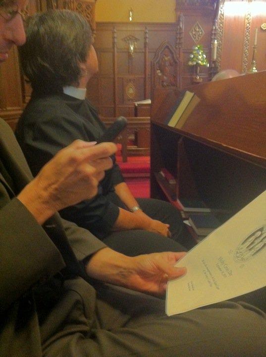 Tim Schenck using a cell phone in church